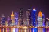 The skyline of the modern and high-rising city of Doha in Qatar, Middle East. - Doha's Corniche in West Bay, Doha, Qatar