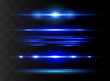 Blue horizontal lens flares pack. Laser beams, horizontal light rays.Beautiful light flares. Glowing streaks on dark background.