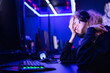 canvas print picture - Streamer beautiful girl regrets losing professional gamer loser playing online games computer, neon color