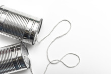 Communications And Business Calls Concept Of Tin Can Telephone With String On Orange