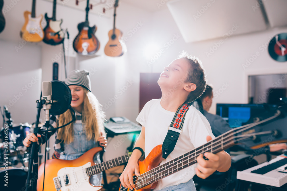Fototapeta kids rock band in music studio