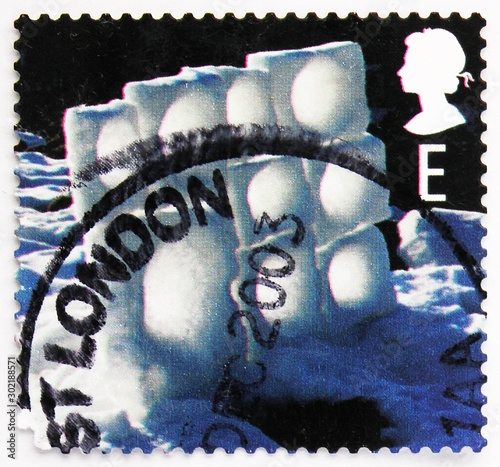 Fotografia  Postage stamp printed in United Kingdom shows Ice Wall, Christmas 2003 - Ice Scu
