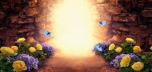 Photo Background With Magical Trail Leading Through Stone Dungeon Grotto Cave Towards Mystical Glow, Fantastic Bluebell, Yellow Rose Flower, Flying Blue Butterflies. Fairytale Tranquil Fantasy Scene.