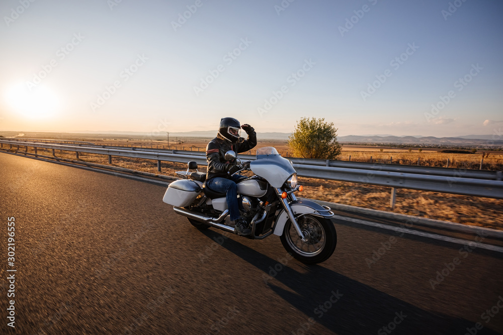 Fototapety, obrazy: Burgas, Bulgaria - September 30.2019 Motorcyclists on а Honda Shadow driving on the asphalt road in rural landscape at sunset with dramatic clouds