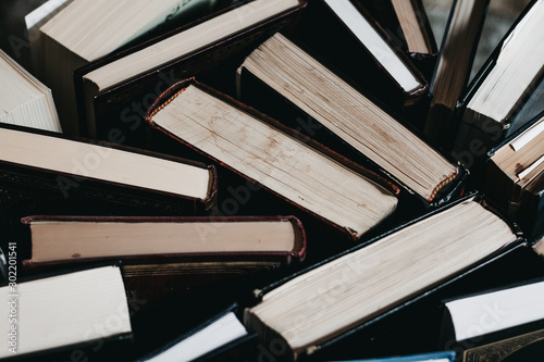 Fotografie, Tablou  many old and used hardback books or text books seen from above , Old books