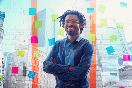 Businessman that smiles in office. Concept of positivity and success