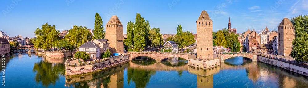 Fototapety, obrazy: Panoramic view of the Ponts Couverts (covered bridges), a medieval set of bridges and defensive towers on the river Ill at the entrance of the Petite France historic quarter in Strasbourg, France.