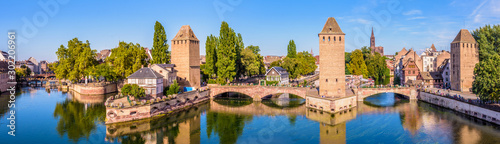 Foto op Aluminium Bruggen Panoramic view of the Ponts Couverts (covered bridges), a medieval set of bridges and defensive towers on the river Ill at the entrance of the Petite France historic quarter in Strasbourg, France.