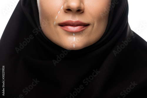 cropped view of young Muslim woman in hijab having marks on face for plastic sur Fototapeta