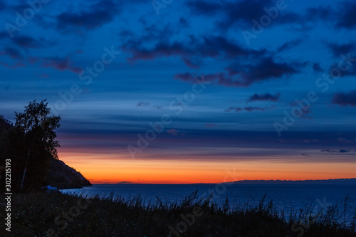 Obraz Before sunrise at Baikal lake with colorful sky - fototapety do salonu