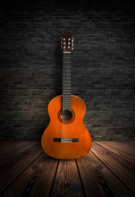 Guitar In A Dark Room With Brick Walls, Wooden Floor. Smoke, Abstract Light. Dark Empty Scene With A Musical Instrument.