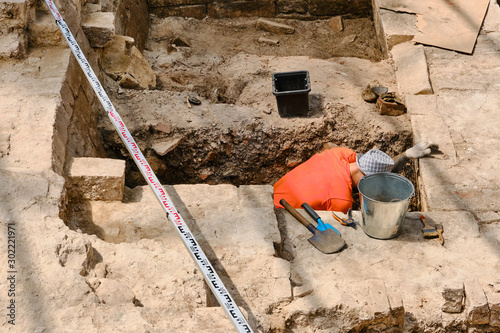 An archaeologist is excavating an ancient building Canvas Print