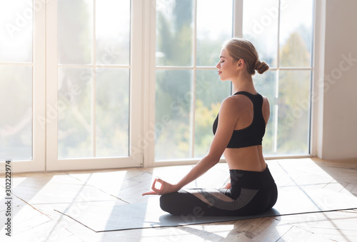 Rear view of girl relaxing in lotus pose