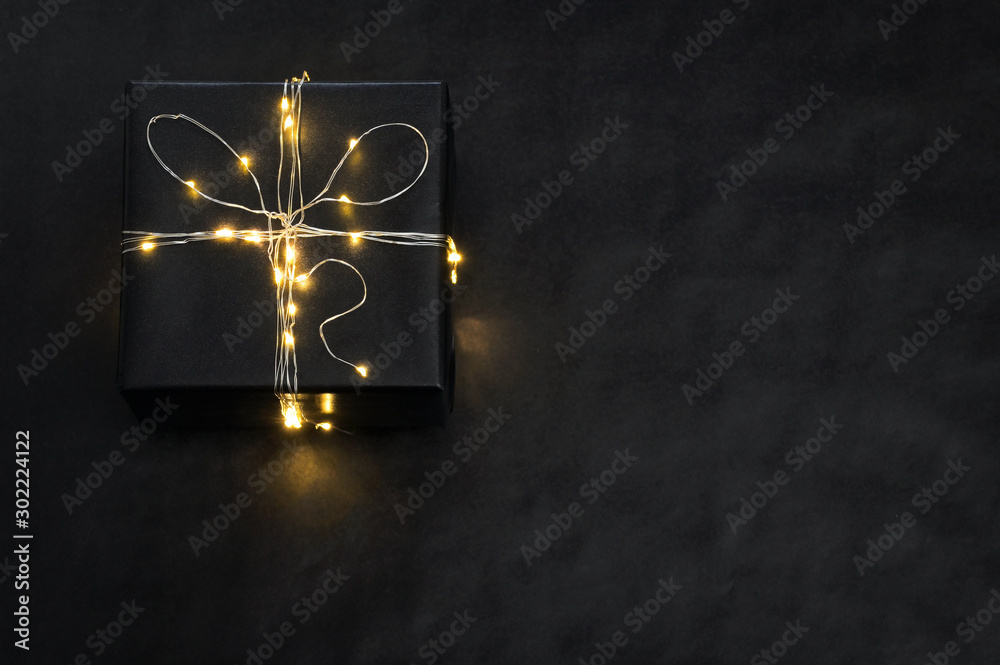Fototapeta Present Box wrapped with string lights