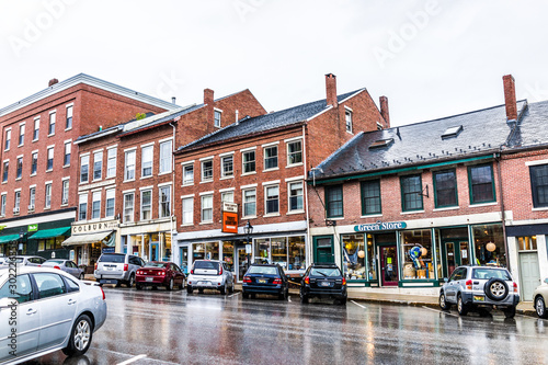 Belfast, USA - June 9, 2017: Empty small village in Maine during rain with stores on steep hill main street