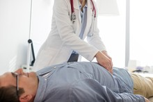 Doctor Examining Patient In Clinic