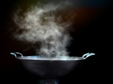 Cook With A Large Steel Pan, B...