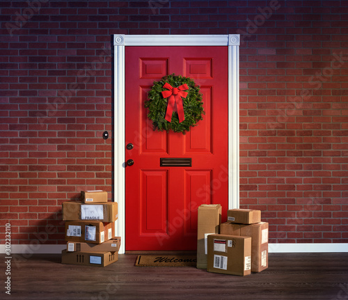 Obraz Last minute Christmas holiday shopping spree boxes delivered to the front door. - fototapety do salonu