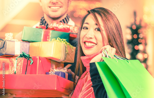 Couple shopping Christmas presents in mall