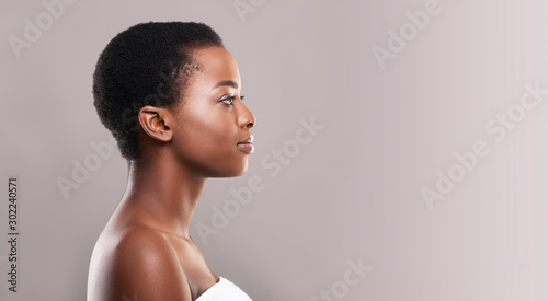 Valokuva  Profile portrait of afro woman with clean flawless skin