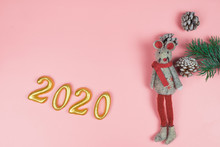 A Gray Toy Mouse, Cones And A Spruce Branch With Gold 2020 Numbers On A Pink Pastel Background. Year Of The Rat 2020, New Year And Christmas Concept. Flat Lay, Copyspace