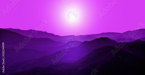 Fotobehang Violet Beautiful landscape with violet misty silhouettes of mountains against shiny full moon