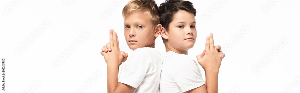 Fototapety, obrazy: panoramic shot of two brothers showing gun gestures and looking at camera isolated on white