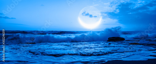 Fotografía Night sky with crescent moon in the clouds Elements of this image furnished by