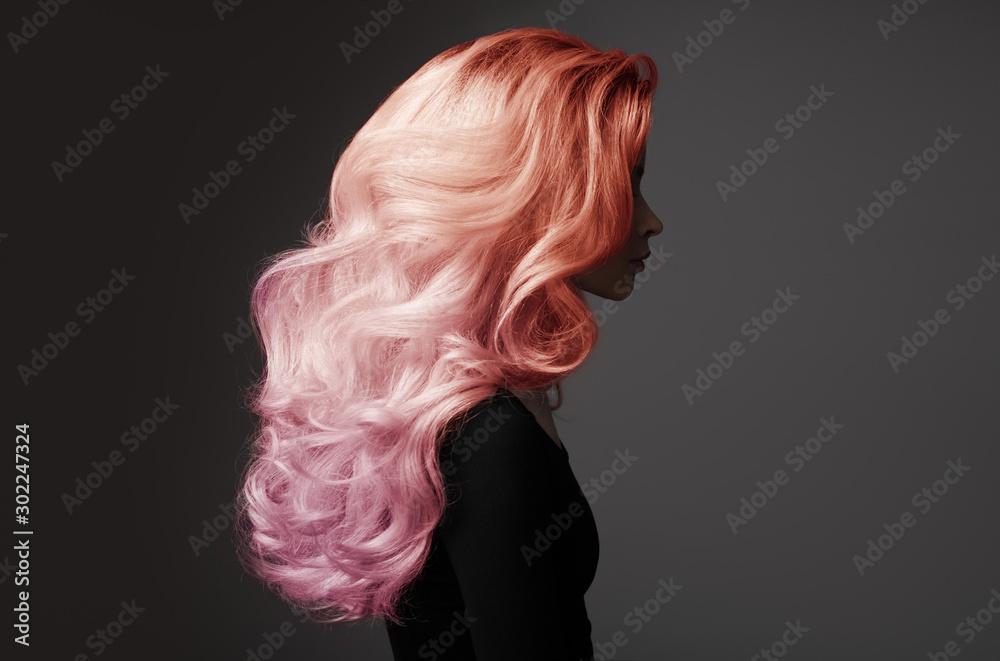 Fototapeta Portrait of beautiful woman with colorful wavy hair.