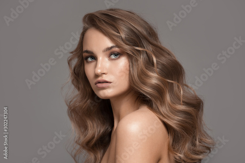 Slika na platnu Portrait of beautiful blonde woman. Volume hairstyle.