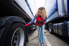 Truck Driver Checking Vehicle Tires And Inspecting Truck Before Ride. Transportation Services.