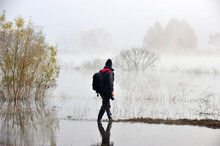 Korean Photographer By The Morning Lake