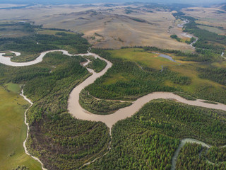 Aerial view of Kurai steppe and Chuya river on North-Chui ridge background. Altai mountains, Russia.