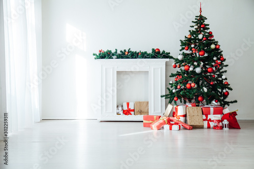 Fotobehang Bomen White Christmas home interior Christmas tree red gifts new year decor festive background