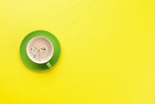 Green Coffee Cup Over Yellow B...