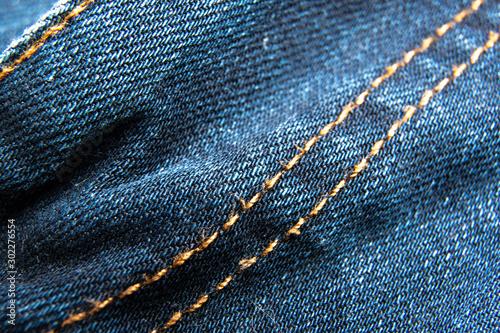 Blue jeans fabric macro seam pattern background / Denim jeans texture / Blue jeans texture for any background.