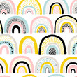Seamless rainbow pattern. Childish colorful hand-drawn background. Trendy illustration in Scandinavian style. Ideal for printing fabric, textile, wrapping paper