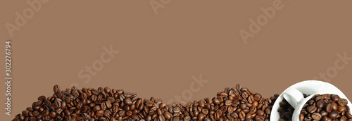Wall Murals Cafe Coffee bean cup on brown background and copy space
