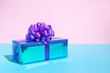 canvas print picture - Gift box in the hologram foil wrapping on the pink blue background