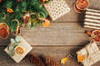 canvas print picture - Christmas boxes with dried mandarin slices on rustic wooden background