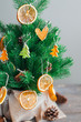 canvas print picture - Dried citrus slices on the Christmas tree on table