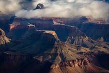 Rock Formations Shrouded In Clouds At The Grand Canyon In Winter