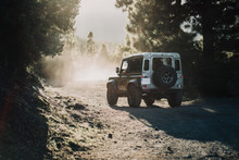 Man Driving A 4x4 During Sunset In The Forest