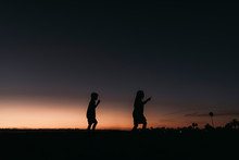 Silhouette Of Brother And Sist...