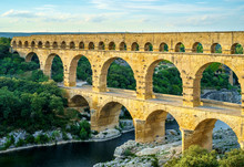 Pont Du Gard Roman Aqueduct Over Gard River In Late Afternoon, France
