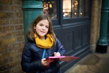 Eight Year Old Girl Writing In...