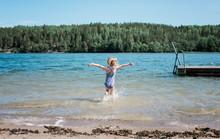 Young Blonde Girl Splashing In...