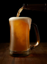 Beer Pouring In Mug