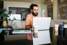 Man Working On Table At Home U...