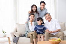 Happy Chinese Family Relaxing ...